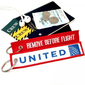 UAL United Airlines New Logo REMOVE BEFORE FLIGHT attendant pilot luggage bag tag keychain