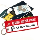 Air New Zealand REMOVE BEFORE FLIGHT attendant pilot luggage bag tag keychain