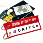 UAL United Airlines REMOVE BEFORE FLIGHT attendant pilot luggage bag tag keychain
