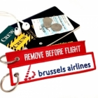 Brussels Airlines REMOVE BEFORE FLIGHT attendant pilot luggage bag tag keychain